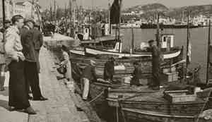 Historical image of boats by the pier